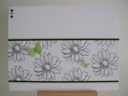 black and white flowers with two green vellum butterflies