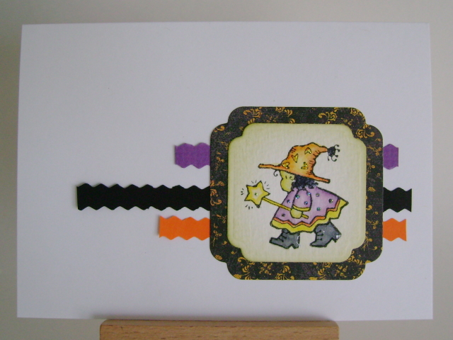 little witch with wand in halloween colours