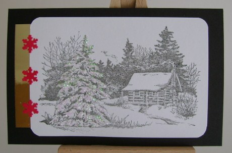 cabin in winter snow with evergreen trees