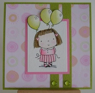 girl in pink with green balloons