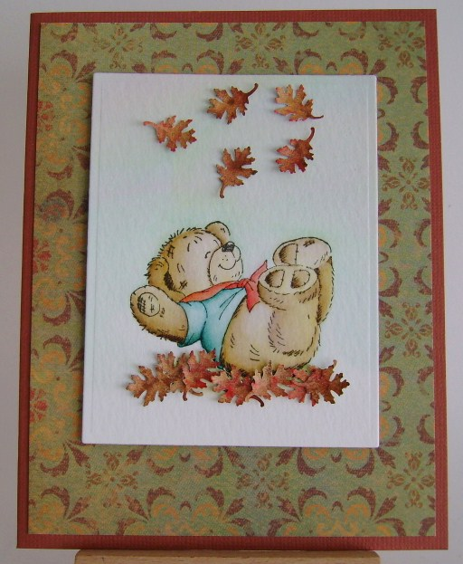 teddy plaing in fall leaves