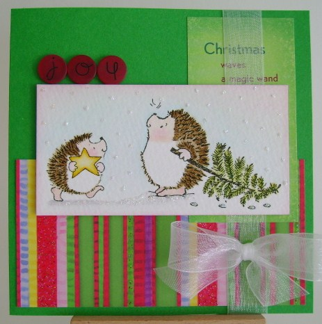 two hedgies with star and christmas tree