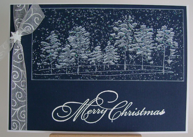 white glittered trees stamped on navy blue