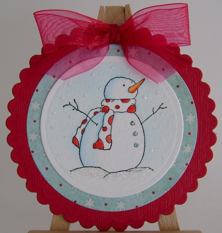 round red card with snowman and red bow