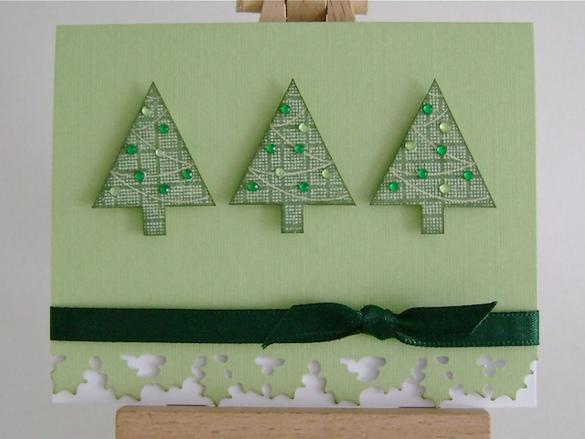 three green trees on green card base with green ribbon