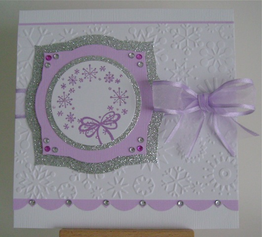 white christmas card with purple snowflake wreath and silver glitter mats
