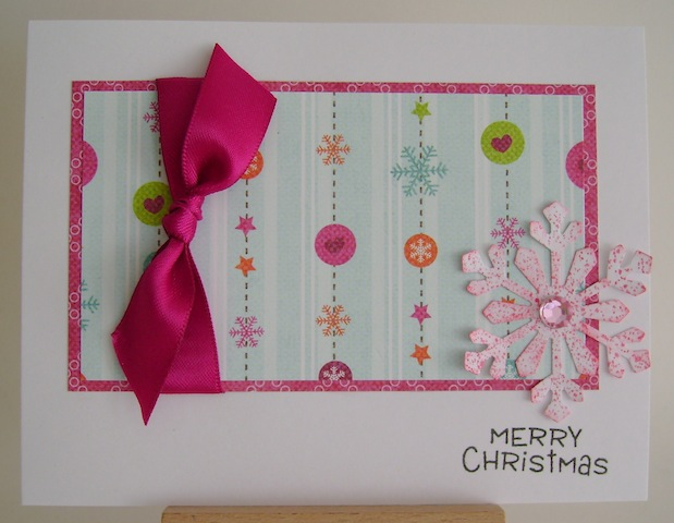 pink bow with pink snowflake christmas card