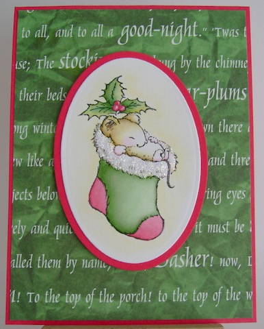 mouse asleep in green stocking
