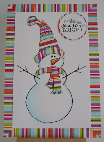 snowman with multistriped hat, scarf and border