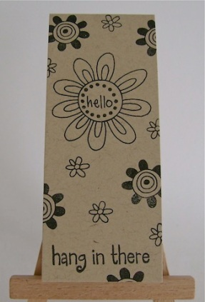 black flowers on kraft paper with hang in there sentiment
