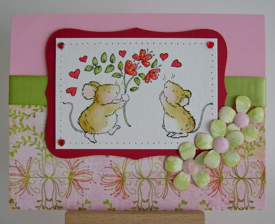 one mice giving another a bouquet of heart flowers