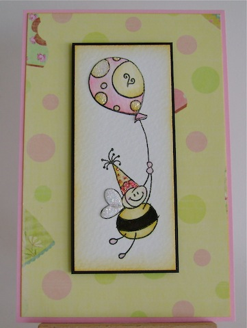 smiling bee with balloon and party hat