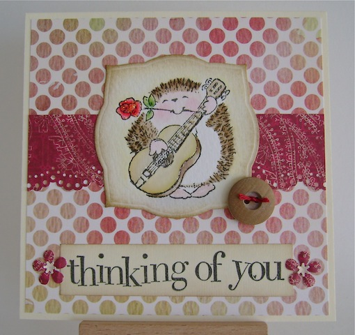 guitar playing hedgehog on red and beige dotted background