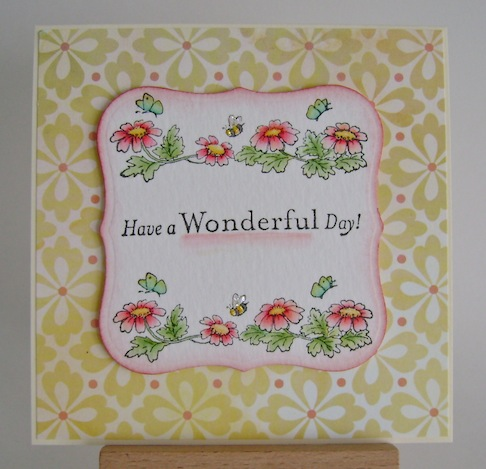 have a wonderful day sentiment with floral border above and below