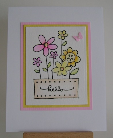 pink, orange and yellow flowers in a pot with hello sentiment