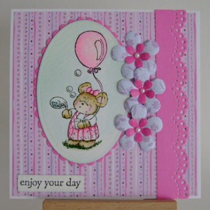 little mouse blowing bubbles in a pink dress and pink balloon