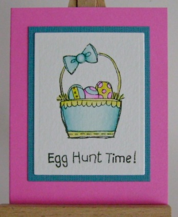 turquoise easter basket with egg hunt time sentiment