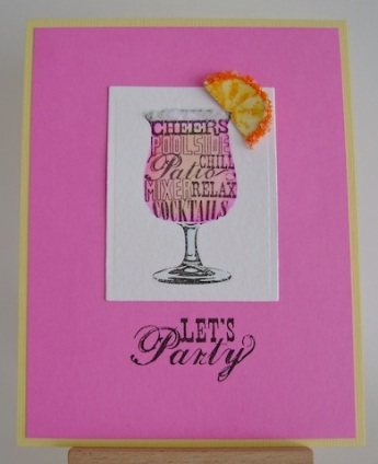 fruit punch in a glass with an orange slice edged with flower soft