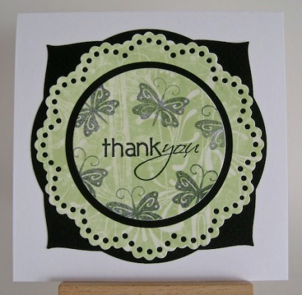 green, black and white thank you card with stamped black butterflies