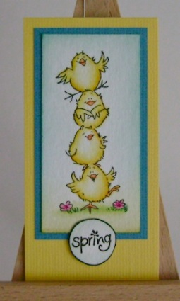 a pile of yellow chick with spring sentiment