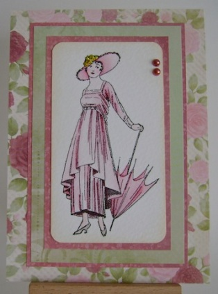 vintage lady with hat and parasol in pink surrounded by pink and green floral paper