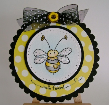 cute bumble bee on yellow dot background paper and black ribbon bow with white dots