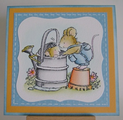two mice in garden with watering can and clay pot