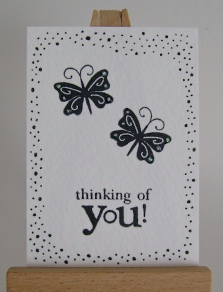 artist trading card with two butterflies, dotted border and thinking of you sentiment