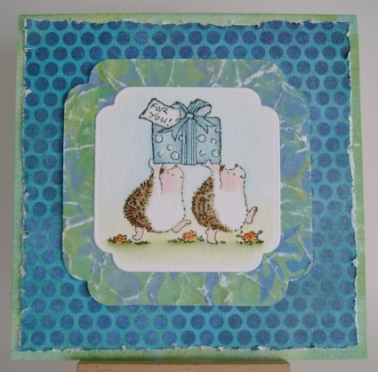 two hedgehogs carrying a gift with for you sentiment on crumpled and distressed blue and green papers