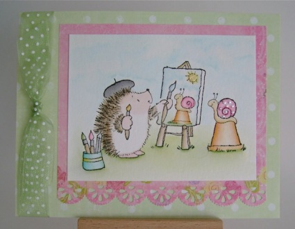 hedgehog painting a snail on clay pot outdoors in summer