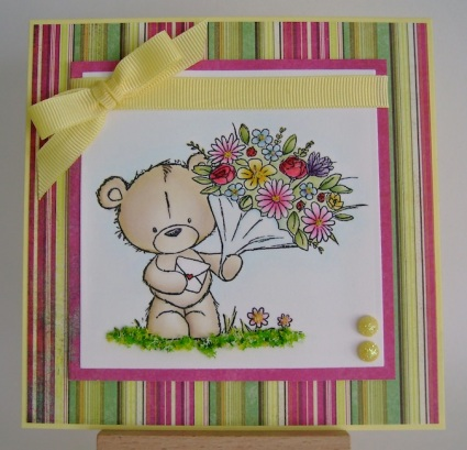 teddy holding bouquet of flowers with bright striped background, yellow bow and ribbon and yellow glitter dots