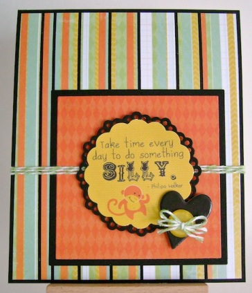 monkey and sentiment to be silly every day with striped background paper in bright yellow orange blue white and black stripes