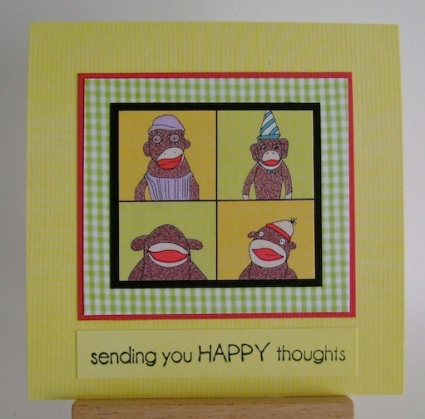 four sock monkeys in a square on square yellow card