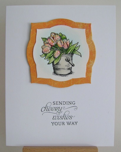 glittered yellow and orange tulips in bucket on clean and simple card