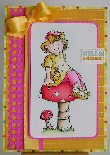 molly sitting on a toadstool card in pink, orange, yellow and red with hello sunshine sentiment