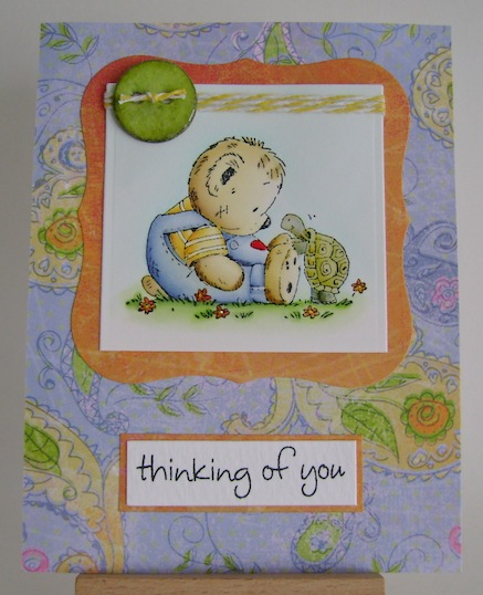 teddy sitting on the ground with turtle in blue green and orange card
