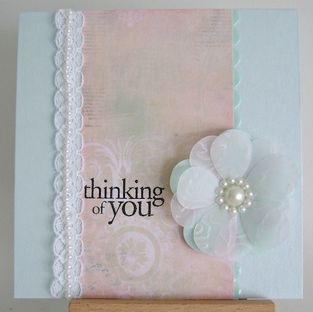 white vellum flower on pink and blue card with thinking of you sentiment