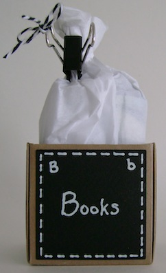 little box with the word books on black paper