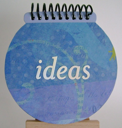 round notebook spiral bound at the top with ideas sentiment in the middle