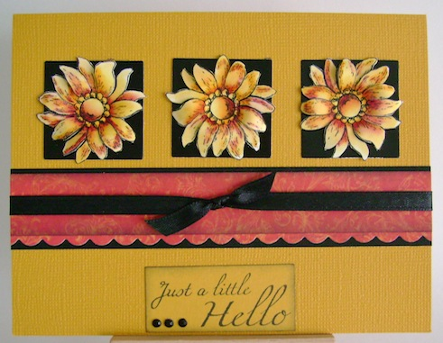 three flowers in yellow, orange and red on black squares with just a little hello sentiment on the bottom of the card