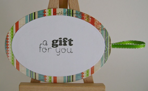 back of snowman gift tag with a gift for you sentiment