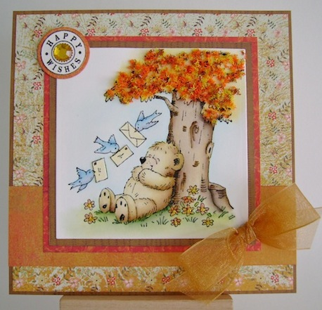 teddy sitting under a fall tree with three bluebirds delivering cards to him for his birthday