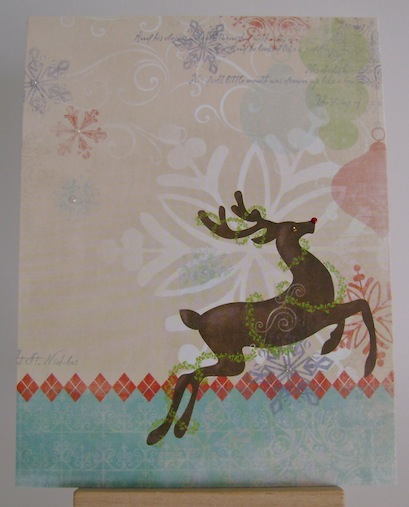 rudolph on a card with snowflakes in the background and a blue border on the bottom