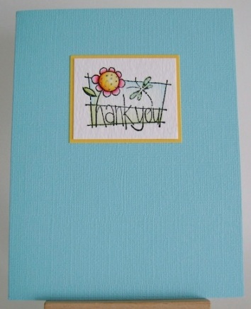 blue card with small pink and yellow flower and thank you sentiment