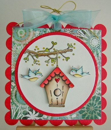 square scalloped card featuring birdhouse hanging from a branch with two blue birds