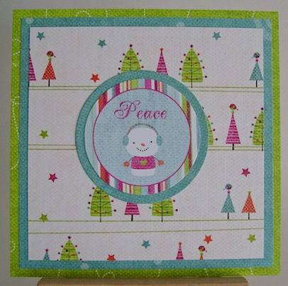 christmas card with snowman and peace sentiment in bright blue, green, pink and orange