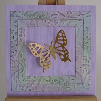 tiny three by three inch card with embossed frame and gold butterfly in the centre