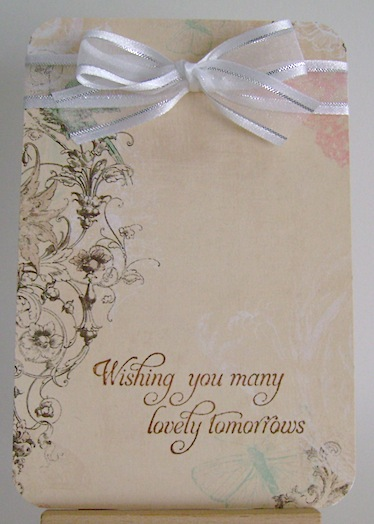 card with brown print and white  bow