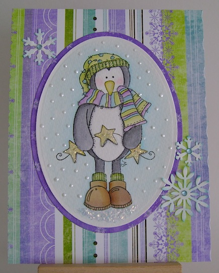christmas card nontraditional colours featuring penguin holding garland of stars