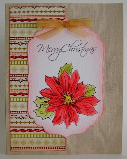 front of christmas card with poinsettia and detachable bookmark